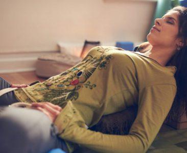 Attractive,Mixed,Race,Woman,Doing,Restorative,Yoga